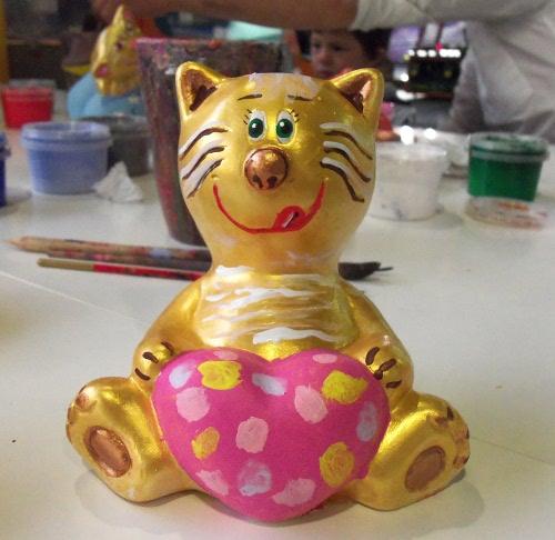 кот копилка золотой