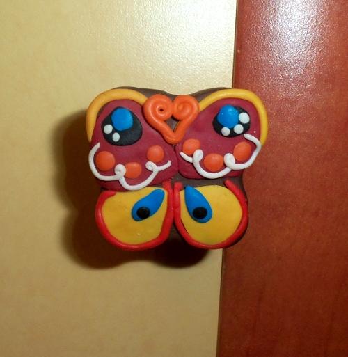 ручка-кнопка бабочка